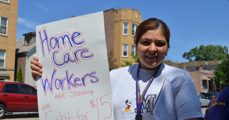 Home care worker holding sign saying home care workers fight for $15