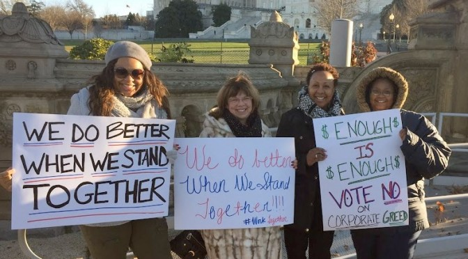 "Home care workers holding signs in Washingotn, D.C. that say ""we do better when we work together"""